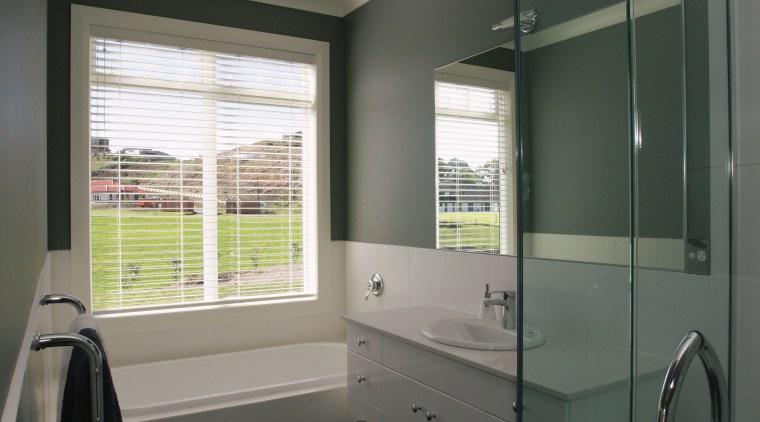 A view of the bathroom, dark grey walls, bathroom, bathroom accessory, bathroom cabinet, home, interior design, real estate, room, window, window covering, window treatment, gray, black