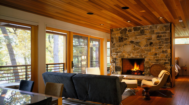 view of the living area featuring a fireplace architecture, beam, ceiling, fireplace, floor, flooring, hardwood, home, house, interior design, living room, log cabin, real estate, room, wall, window, wood, wood flooring, brown