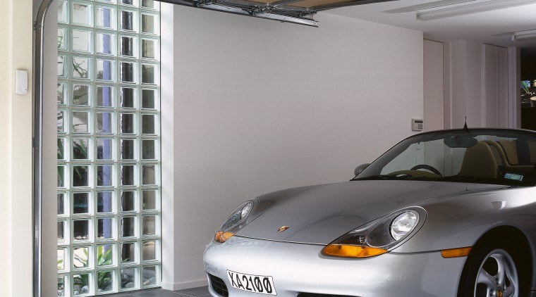 view of this garage featuring a garage window automotive design, automotive exterior, car, garage, material, motor vehicle, porsche, sports car, technology, vehicle, vehicle door, window, gray