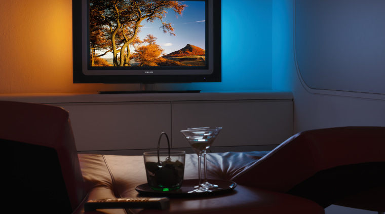 the phillips ambilight 2 technology provides ambient colour display device, entertainment, flat panel display, furniture, home, interior design, lighting, living room, multimedia, room, television, black