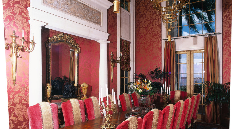 view of the formal dining room featuring antique chair, dining room, function hall, furniture, home, interior design, living room, room, table, wall, red