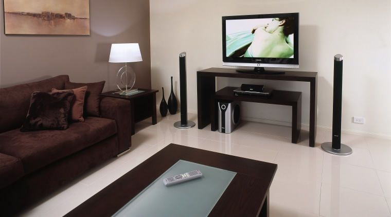 samsungs 40inch m series lcd tv has a floor, furniture, interior design, living room, property, room, suite, table, gray, black