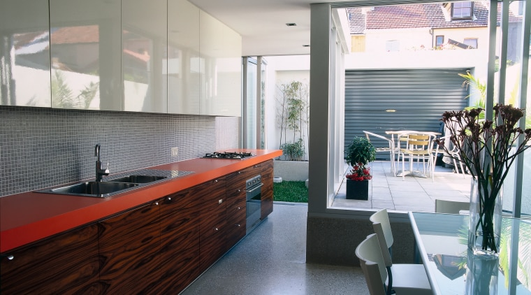 A view of a kitchen, polished concrete floor, architecture, countertop, interior design, kitchen, room, gray