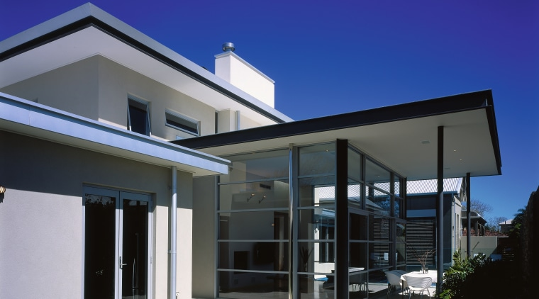 Exterior view of outside seated area as well architecture, building, daylighting, elevation, facade, home, house, property, real estate, residential area, roof, sky, window, blue, black