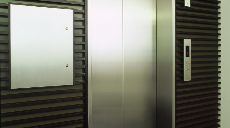 A view of an elevator. architecture, door, elevator, black