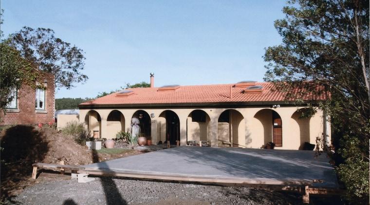 Origional Hacienda-style house prior to the renovations using building, estate, facade, hacienda, historic site, house, property, real estate, villa, teal, black