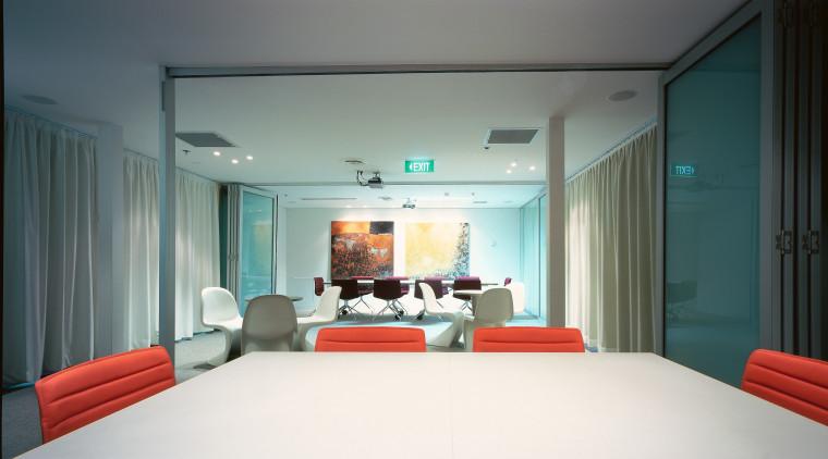 A view of the boradroom, lagre wooden desks, architecture, ceiling, interior design, room, gray, black