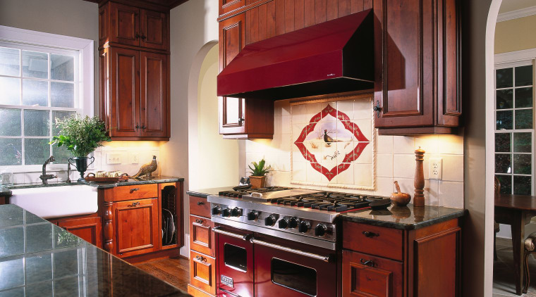 A view of a kitchen, wooden flooring and cabinetry, countertop, cuisine classique, hardwood, interior design, kitchen, room, red