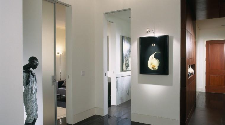 A view of a hallway, wooden flooring, spot ceiling, exhibition, floor, interior design, lobby, gray, black