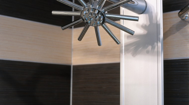 A view of a shower head. lighting, product design, black