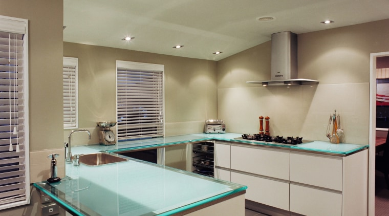 Hansen designed and manufactured this kitchen using glass ceiling, countertop, interior design, kitchen, lighting, real estate, room, gray