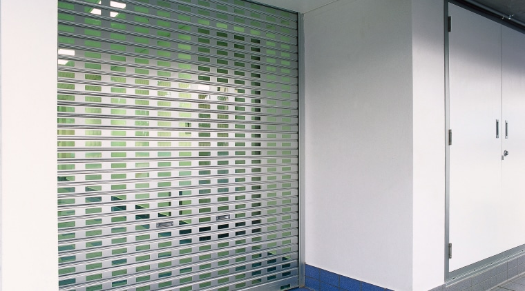 View of slotted aluminium roller shutter door. architecture, daylighting, glass, wall, gray, white