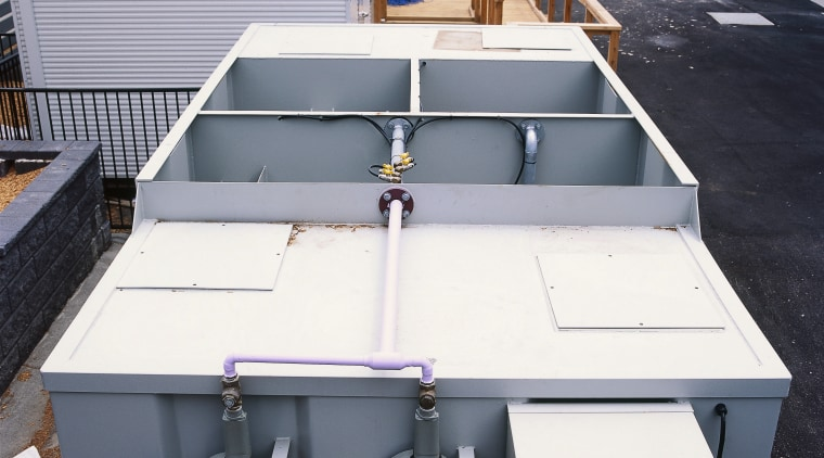 Large grey water treatment tanks. boat, roof, vehicle, gray, black