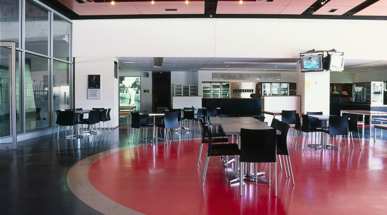 Large public cafe with charcoal, stone grey and interior design, black, red