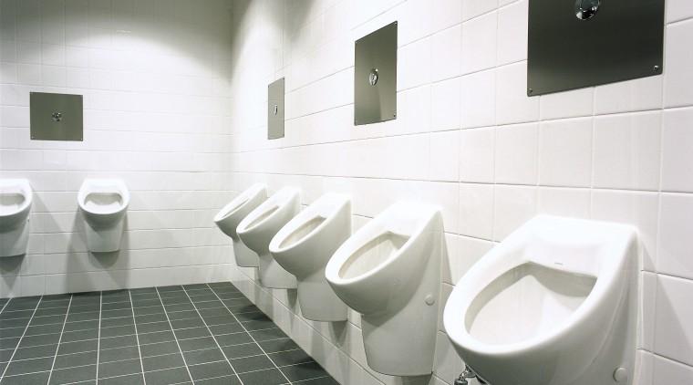 Men's bathroom with wall mounted sanitaryware. architecture, bathroom, ceramic, daylighting, floor, flooring, interior design, plumbing fixture, product design, public toilet, sink, tap, tile, toilet, urinal, wall, gray, white