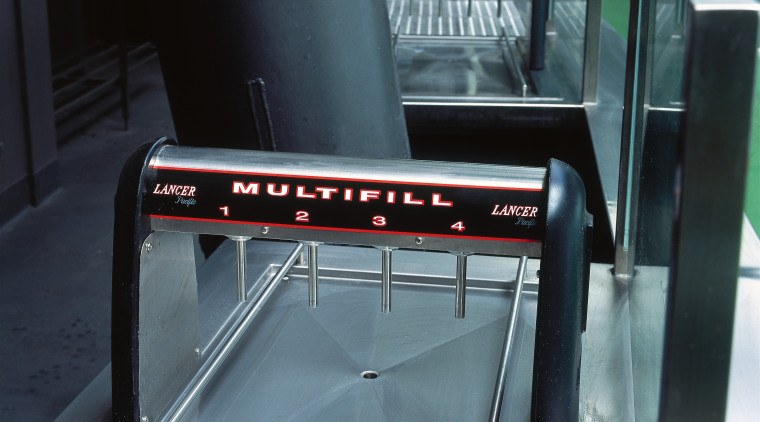 View of Lancer Multifill drink dispensing equipment. automotive exterior, furniture, product, structure, table, black, gray