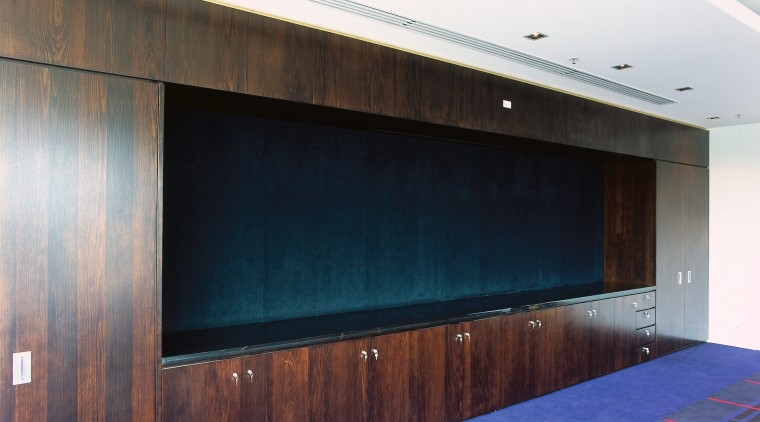 Dark timber cabinetry along wall, with blue and architecture, ceiling, door, floor, flooring, interior design, wall, wood, white, black
