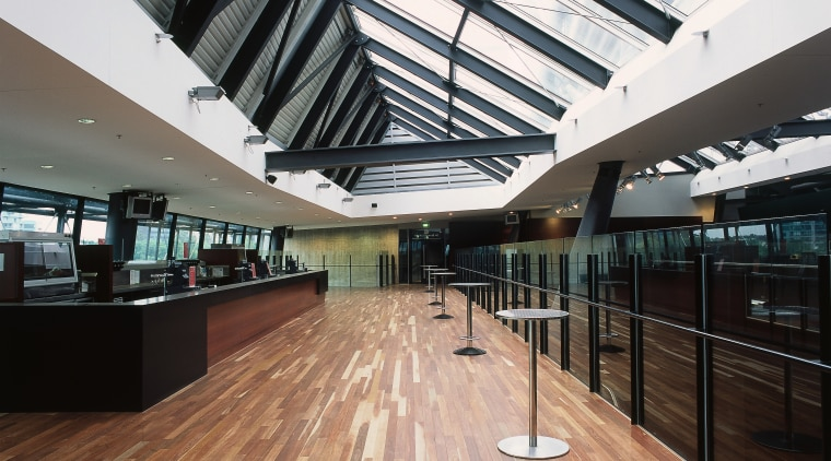 Large bar area with glass roof panels and architecture, building, ceiling, daylighting, floor, flooring, interior design, lobby, roof, structure, wood, black, white