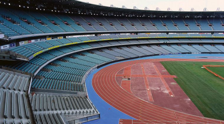 View of enormous stadium with rows of seats, amphitheatre, arena, atmosphere, atmosphere of earth, daytime, landmark, line, metropolitan area, sky, soccer specific stadium, sport venue, stadium, structure, white