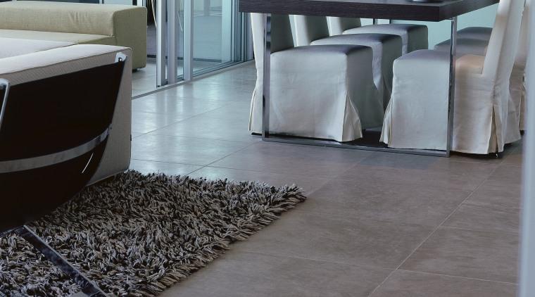 Apartment with natural limestone flooring, upholstered dining chairs floor, flooring, hardwood, interior design, laminate flooring, table, tile, wood, wood flooring, gray
