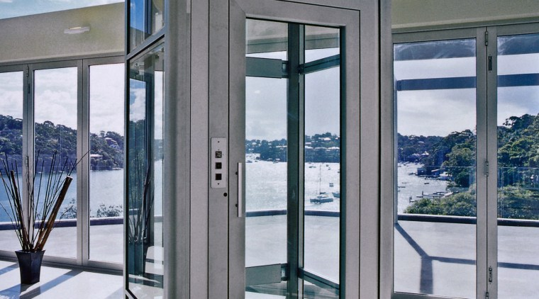 View of small elevator with glass door and door, glass, window, gray, white