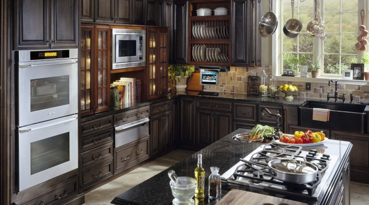 Traditional style kitchen with dark cabinetry, and matte cabinetry, countertop, cuisine classique, home appliance, interior design, kitchen, kitchen appliance, room, black, gray