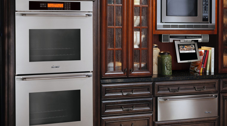 View of traditional style kitchen with dark wood cabinetry, countertop, furniture, home appliance, kitchen, kitchen appliance, kitchen stove, major appliance, microwave oven, oven, refrigerator, black, gray