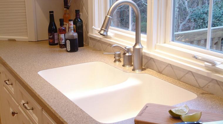View of kitchen countertop showing undermount sink. bathroom, bathroom sink, countertop, floor, flooring, interior design, kitchen, plumbing fixture, room, sink, tap, white, brown