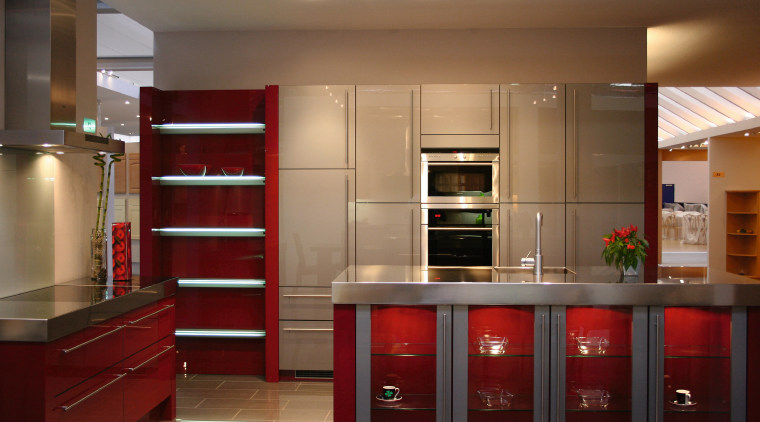 Kitchen with red cabinetry and shelving, stainless steel cabinetry, countertop, furniture, interior design, kitchen, room, shelving, brown, red