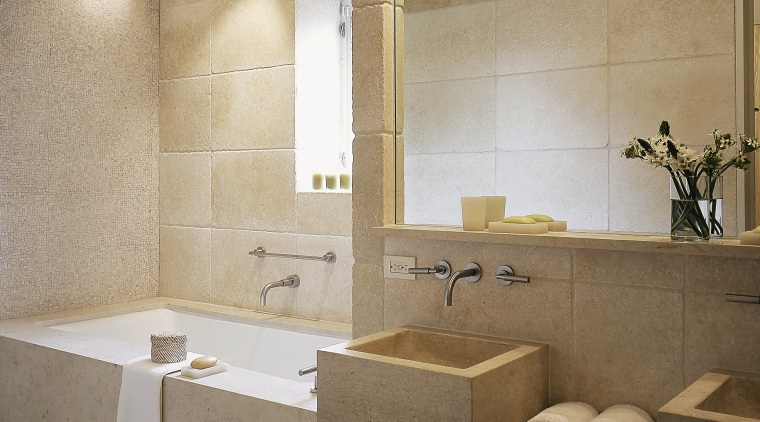 View of this bathroom featuring two seater bathtub, architecture, bathroom, ceiling, floor, flooring, interior design, plumbing fixture, room, sink, tile, wall, gray, brown