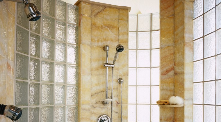 A view of the shower, glass tiled walls, bathroom, ceiling, floor, flooring, interior design, plumbing fixture, room, tile, wall, brown, gray