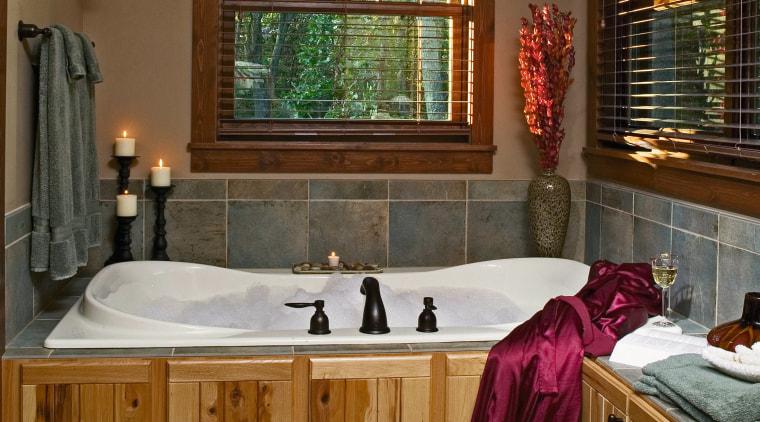 Bathroom with white whirlpool bath and timber surround, bathroom, estate, floor, flooring, home, interior design, room, window, brown