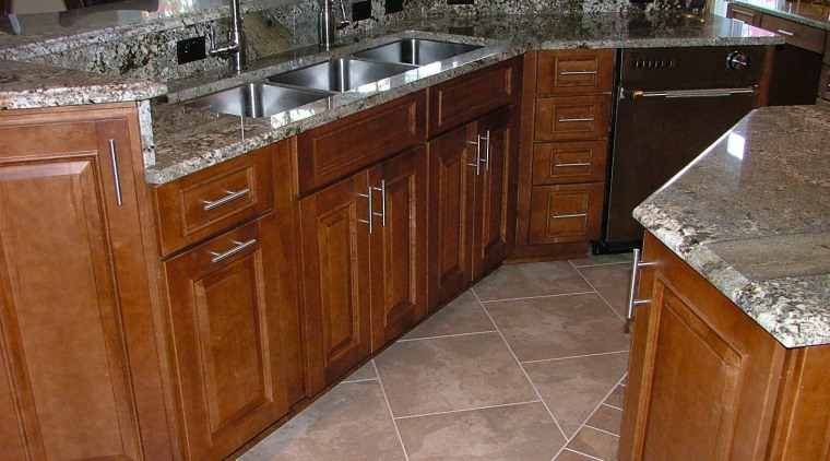 Kitchen with timber cabinetry, granite countertops, three stainless cabinetry, countertop, floor, flooring, furniture, granite, hardwood, kitchen, room, tile, wood flooring, wood stain, brown, gray