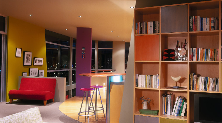 A view of the living and kitchen areas, bookcase, furniture, home, interior design, living room, room, shelf, shelving, brown