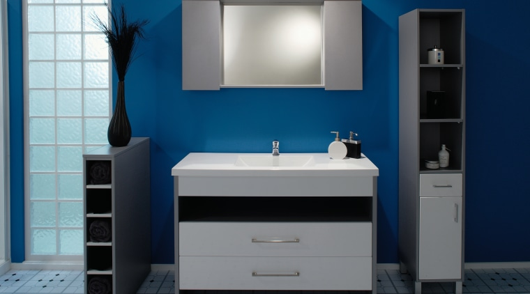 A view of a bathrom designed by Vogue bathroom, bathroom accessory, bathroom cabinet, product, product design, room, sink, blue, gray