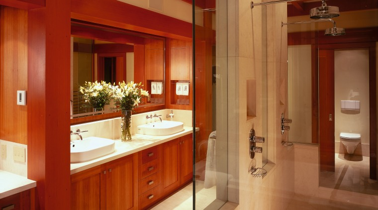 view of this bathroom featuring cherry wood vanity/cabinetry, bathroom, cabinetry, ceiling, countertop, interior design, kitchen, room, brown, red