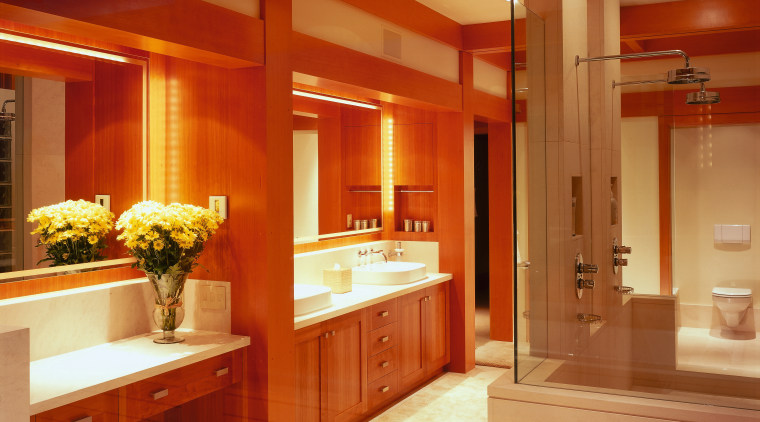 view of this bathroom featuring cherry wood vanity/cabinetry, bathroom, cabinetry, ceiling, countertop, home, interior design, kitchen, lighting, room, red, orange