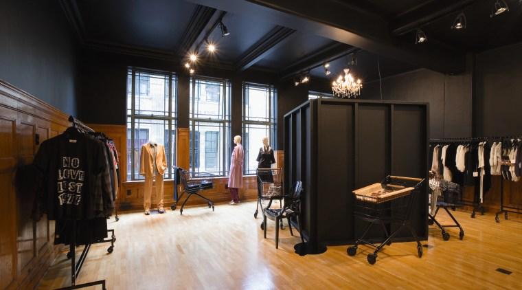 A view of a store, wooden flooring. ceiling, floor, flooring, furniture, interior design, wood, black