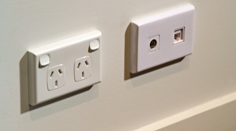 View of phone and tv ports. ac power plugs and socket outlets, computer component, electronic device, electronics accessory, power supply, product design, technology, gray