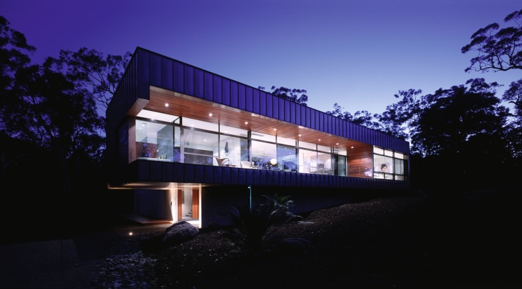 Exterior view of large home with expansive glazing architecture, building, corporate headquarters, facade, home, house, lighting, night, property, real estate, reflection, residential area, sky, blue, black