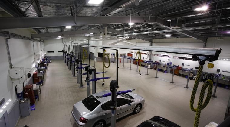 A view of the Puegot showroom. automobile repair shop, automotive design, car, factory, motor vehicle, structure, black, gray