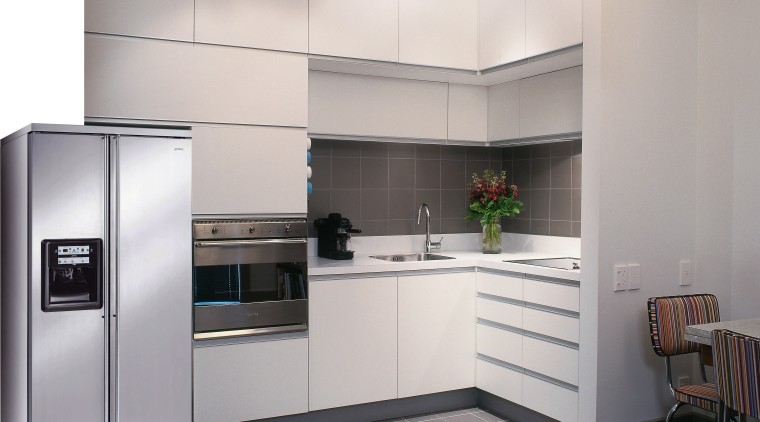 view of this clean kitchen featuring smeg electric cabinetry, countertop, cuisine classique, home appliance, interior design, kitchen, kitchen appliance, kitchen stove, major appliance, product design, refrigerator, small appliance, white, gray