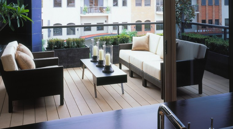 view of the outdoor entertainment area featuring cane architecture, daylighting, furniture, interior design, living room, table, window, black