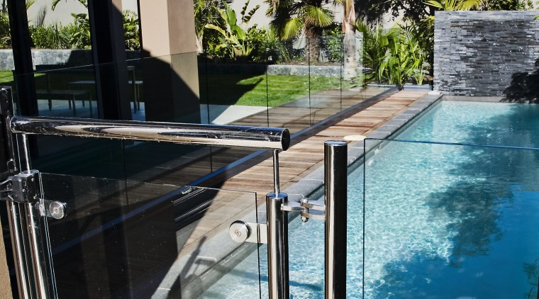 A view of some balustrades from ProStainless. house, outdoor structure, property, real estate, reflection, sky, swimming pool, water, black