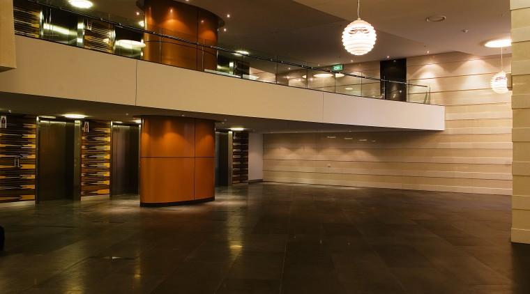Lobby area of apartment building featuring limestone tiles architecture, ceiling, floor, flooring, hardwood, interior design, lighting, lobby, wood, brown