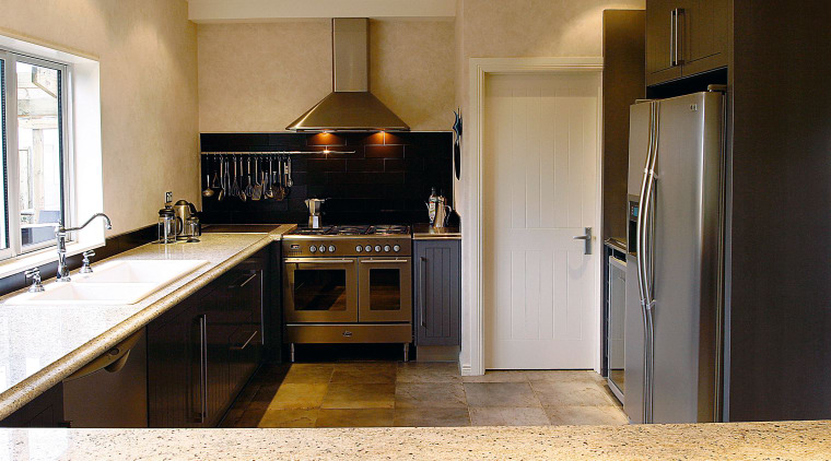 A view of a kitchen designed by Pauline cabinetry, countertop, cuisine classique, floor, flooring, home appliance, interior design, kitchen, real estate, room, brown, white