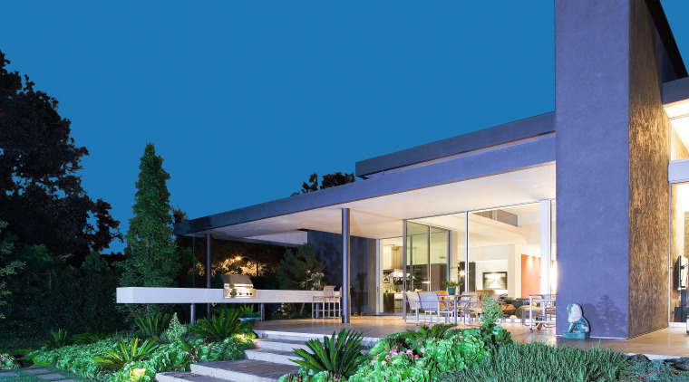 An exterior view of the patio area. architecture, elevation, estate, facade, home, house, property, real estate, residential area, villa, teal