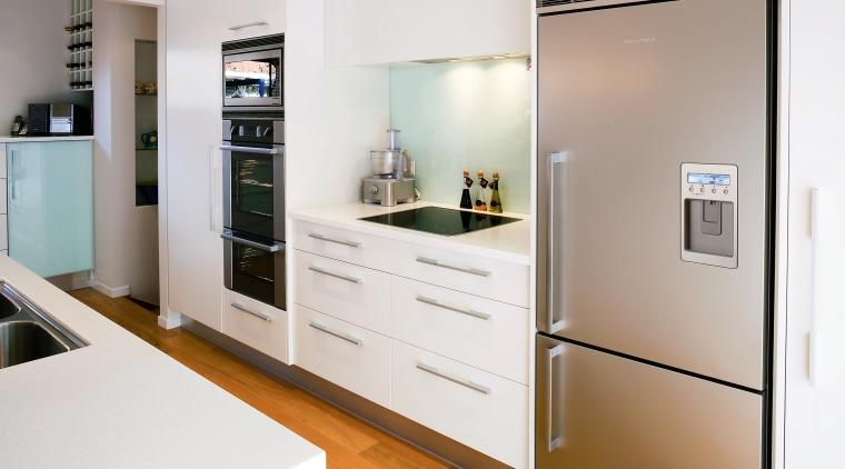 White kitchen with stainless steel refrigerator. countertop, home appliance, interior design, kitchen, major appliance, room, white