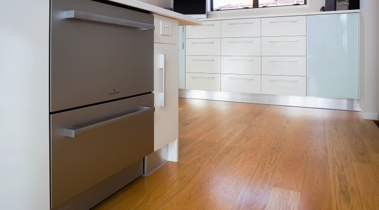 View of stainless steel dishdrawer dishwasher. cabinetry, chest of drawers, drawer, floor, flooring, furniture, hardwood, home, laminate flooring, property, room, wall, wood, wood flooring, wood stain, white, brown