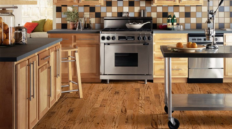 A view of some wooden flooring by Armstrong. cabinetry, countertop, cuisine classique, floor, flooring, hardwood, interior design, kitchen, laminate flooring, tile, wood, wood flooring, brown